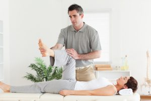A chiropractor is working with a customer